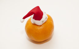Christmas mandarins. Christmas tangerine in a hat of Santa Claus Royalty Free Stock Photography