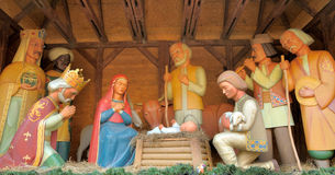 Christmas Manger scene with figurines including Jesus, Mary, Jos. Eph, sheep and magi stock image