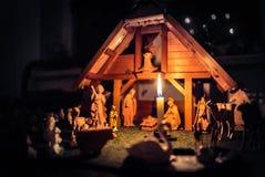 Christmas Manger scene and figurines. Christmas Manger scene with figurines including Jesus, Mary, Joseph, sheep and magi Stock Photography
