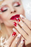 Christmas manicure with Santa Claus. Royalty Free Stock Images
