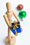 Christmas Mannequin. Wooden Mannequin holding Christmas ornaments royalty free stock images