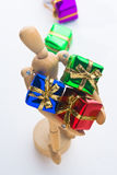 Christmas Mannequin. Wooden Mannequin holding Christmas ornaments Stock Image