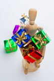 Christmas Mannequin. Wooden Mannequin holding Christmas ornaments stock photography