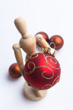 Christmas Mannequin. Wooden Mannequin holding Christmas ornaments royalty free stock image