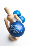 Christmas Mannequin. Wooden Mannequin holding Christmas ornaments royalty free stock photos