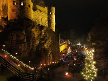Christmas market at medieval castle by night Stock Image