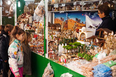 Christmas market. BARCELONA, SPAIN - DECEMBER 12: People near stand with figures for creating Christmas scenes at Christmas market on December 12, 2013 in Stock Image