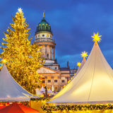 Christmas market in Berlin. Christmas market and French church in Berlin, Germany Stock Photos