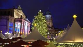 Christmas market in Berlin. Gendarmenmarkt Christmas market kiosks in Berlin illuminated at night, Germany stock footage