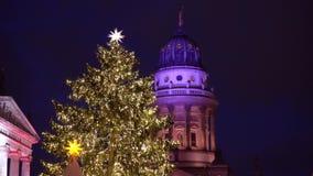 Christmas market in Berlin. Gendarmenmarkt Christmas market tree in Berlin illuminated at night, Germany stock footage