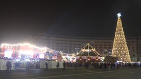 Christmas market with big christmas tree. Christmas market panoramic view with a big lighted christmas tree and people walking around stock video footage