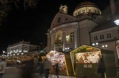 Christmas market booth with kurhaus in Merano south tyrol italy. Christmas market booth in Merano south tyrol italy, with a beautiful light during night stock photography