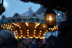 Christmas market in Cologne. With a lamp in the foreground and a carousel in the background Royalty Free Stock Images