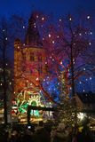 Christmas market in Cologne. Lighting of building, carousel and trees Royalty Free Stock Photos