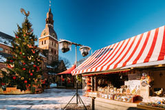 Christmas Market On Dome Square With Riga Dome Cathedral In Riga. Christmas Market On The Dome Square With Riga Dome Cathedral In Riga, Latvia. Christmas Tree Royalty Free Stock Images