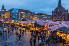Christmas Market at dusk- Nuremberg, Germany. Christmas Market (Christkindlesmarkt) - meetings people - lot of stalls side by side-  evening scenery- Nuremberg ( Royalty Free Stock Photos