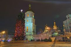 Christmas market in the early morning on Sophia Square in Kyiv, Ukraine. Main Kyiv`s New Year tree and Saint Sophia Cathedral on the background Royalty Free Stock Photography