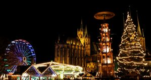 Christmas market in Erfurt with view over christmas tree and pyramide to cathedral stock image