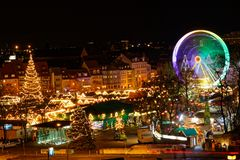 Christmas market in Erfurt with view over christmas tree and rolling high wheel stock photos