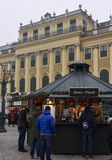Christmas market in the forecourt of Schonbrunn palace. VIENNA, AUSTRIA - JANUARY 2 2016: Christmas market in the forecourt of Schonbrunn palace, with people Royalty Free Stock Images