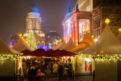 Christmas market, Gendarmenmarkt, Berlin. The Gendarmenmarkt is a square in Berlin, and the site of the Konzerthaus and the French and German Cathedrals. An Royalty Free Stock Images