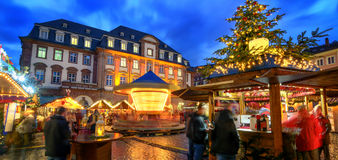 Christmas market in Heidelberg, Germany. A panorama shot at dusk showing illuminated kiosks, architecture and blurred people stock photography