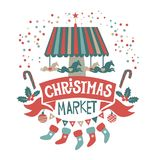 Christmas market illustration. Hand-lettering Christmas market on the red ribbon, surrounded by Christmas decorations: carousel with horses, stockings, garland Stock Photo
