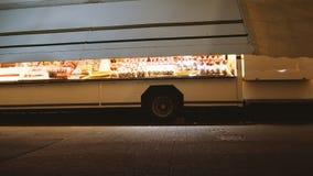 Christmas Market installation before inauguration pedestrian walking. STRASBOURG, FRANCE - CIRCA 2018: Pedestrian walking near Christmas market stalls with stock video footage