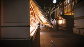 Christmas Market installation before inauguration in Place Broglie near Mairie. STRASBOURG, FRANCE - CIRCA 2018: Owner arranging the Christmas market stalls with stock video footage