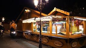 Christmas Market installation before inauguration selling hot wine and food. STRASBOURG, FRANCE - CIRCA 2018: Owners arranging the Christmas market stalls with stock video