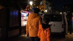 Christmas Market installation before inauguration in Strasbourg, France. STRASBOURG, FRANCE - CIRCA 2018: Pedestrians walking near Christmas market stalls stock footage