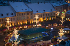 Christmas market and lights in old town square Royalty Free Stock Photography