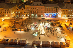 Christmas Market in Litomerice, Czech Republic. LITOMERICE, CZECH REPUBLIC - 19 DECEMBER 2010: An unidentified group of people enjoy Christmas market in Stock Image