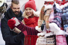 Christmas market with loving person. Big choice of warm winter socks Royalty Free Stock Photos