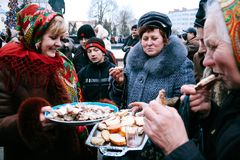 Christmas market. LUTSK, UKRAINE - January 11, 2009: Woman treats passersby with sandwiches at traditional Christmas market on Teatralna Square Stock Photography
