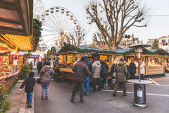 Christmas market in Luxembourg. LUXEMBOURG, LUXEMBOURG - DECEMBER 8, 2016: Christmas market and amusement park in `Place de la Constitution` with people walking Royalty Free Stock Image