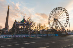 Christmas market in Luxembourg. LUXEMBOURG, LUXEMBOURG - DECEMBER 8, 2016: Christmas market and amusement park in `Place de la Constitution` at sunset. On the Royalty Free Stock Photo