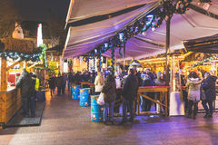 Christmas market in Luxembourg. LUXEMBOURG, LUXEMBOURG - DECEMBER 7, 2016: Christmas market in `Place d`Armes` with people eating typical food. One of the major Stock Photography