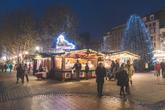 Christmas market in Luxembourg. LUXEMBOURG, LUXEMBOURG - DECEMBER 7, 2016: Christmas market in `Place d`Armes` with people walking around. One of the major Stock Photography