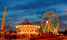 Christmas market in Luxembourg in place de la Constitution. Ferris wheel , carousel and statue of Golden Lady at Luxembourg Christmas market Stock Images