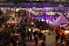 Crowd of people at food stalls in Christmas Market from Munich Airport, wide view, Germany stock images