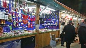 Christmas market near Sagrada Familia. BARCELONA, SPAIN - NOVEMBER 30, 2015: Kiosk with traditional Christmas gifts in evening. Barcelona, Catalonia. Christmas