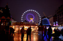 Christmas market at night in Copenhagen. Christmas market in the city of Copenhagen, Denmark, lights and decorations, a big illuminated ferries wheel, people stock image
