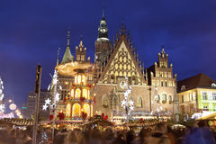 Christmas market in the Old Market Square in front of City Hall in Wroclaw, Poland Royalty Free Stock Image