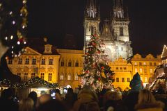 Christmas market with people and Christmas tree in Old Town Square royalty free stock photos