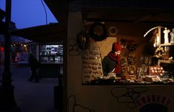 Christmas market in Poland. Lodz, Poland - 22 December 2012. A woman selling handicraft in Christmas market Royalty Free Stock Image