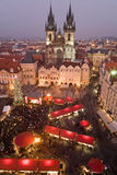 Christmas market in Prague. Sunset on Old Town Square with St. Teyn gothic cathedral in Prague during Christmas market Stock Images