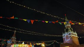 Christmas market in red square. Snowfall Xmas decorations Night time Slow Motion stock video footage