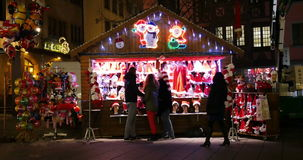 Christmas Market selling Santa Claus hats and other Christmas accessories stock video