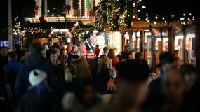 Christmas Market. Shoppers visit the German Christmas Market at Broadmead on November 7, 2014 in Bristol, UK. Broadmead is the city's principal shopping district Stock Photography